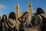 A group of teenagers chat in front of a  church as they wait for school time in Eldorado town, south of Sao Paulo, Brazil, Tuesday, Nov. 27, 2018.  (Dado Galdieri)