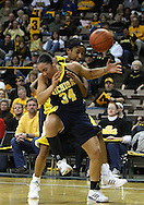 26 JANUARY 2009: Michigan guard Jessica Minnfield (34) and Michigan guard Veronica Hicks (3) collide while going after a rebound during the first half of an NCAA women's college basketball game Monday, Jan. 26, 2009, at Carver-Hawkeye Arena in Iowa City, Iowa. Iowa defeated Michigan 77-69.