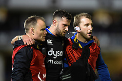 Max Green of Bath Rugby is helped from the field by Joey Hayes and Byron Field - Mandatory byline: Patrick Khachfe/JMP - 07966 386802 - 10/01/2020 - RUGBY UNION - The Recreation Ground - Bath, England - Bath Rugby v Harlequins - Heineken Champions Cup