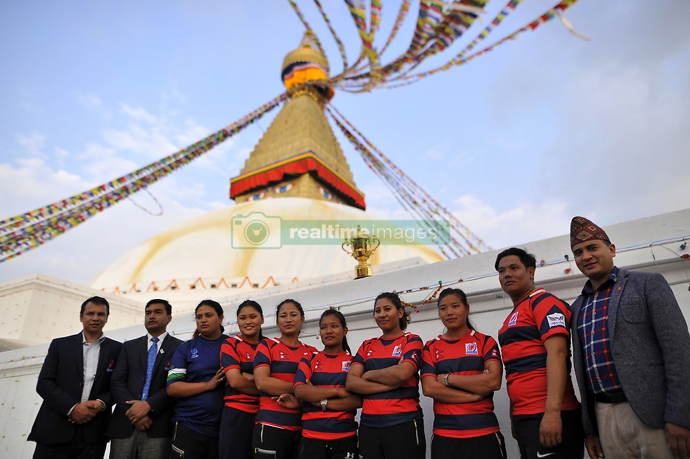 December 7, 2018 - Kathmandu, Nepal - Nepalese women rugby players along with coach takes group photos along with the Webb Elllis Rugby World Cup 2019 Trophy infront Boudhanath Stupa, UNESCO World heritages site during a country tour in Kathmandu, Nepal on Friday, December 07, 2018. The 2019 Rugby World Cup will be the ninth Rugby World Cup, and is to be hosted by Japan from 20 September to 2 November, 2019. (Credit Image: © Narayan Maharjan/NurPhoto via ZUMA Press)
