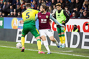 Norwich City defender Grant Hanley (5) challenged by Burnley forward Jay Rodriguez (19)  during the The FA Cup match between Burnley and Norwich City at Turf Moor, Burnley, England on 25 January 2020.