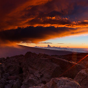 The sun reaches the horizon at the end of another day on the Hawaiian Volcano of Mauna Kea.