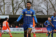 Lyle Taylor of AFC Wimbledon celebrates during the Sky Bet League 2 match between AFC Wimbledon and Luton Town at the Cherry Red Records Stadium, Kingston, England on 13 February 2016. Photo by Stuart Butcher.