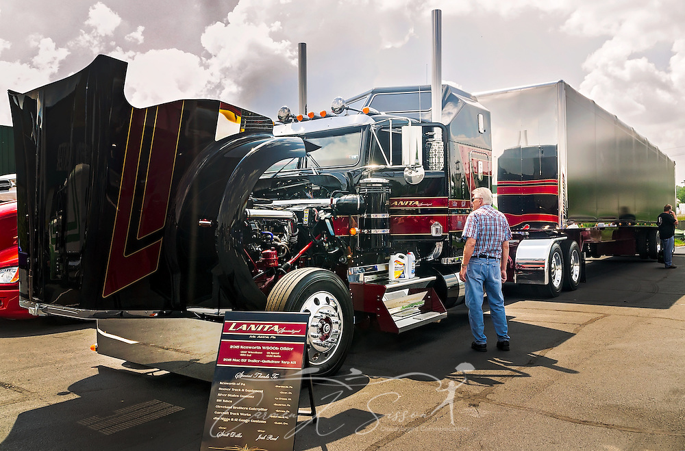 Lanita Transport's 2015 Kenworth W900L and Mac trailer waits to be judged at the 34th annual Shell Rotella SuperRigs truck beauty contest, June 11, 2016, in Joplin, Missouri. SuperRigs, organized by Shell Oil Company, is an annual beauty contest for working trucks. Approximately 89 trucks entered this year's competition. (Photo by Carmen K. Sisson/Cloudybright)