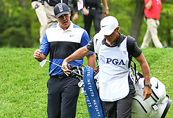 May 19, 2019 - Farmingdale, NY, U.S. - FARMINGDALE, NY - MAY 19: Brooks Koepka of the United States talks with his caddie during the Final Round of the 2019 PGA Championship, on the Black Course, Bethpage State Park, in Farmingdale, NY. (Photo by Joshua Sarner/Icon Sportswire) (Credit Image: © Joshua Sarner/Icon SMI via ZUMA Press)