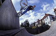 BMXer wallride off mini-ramp, U.K, 2000s.