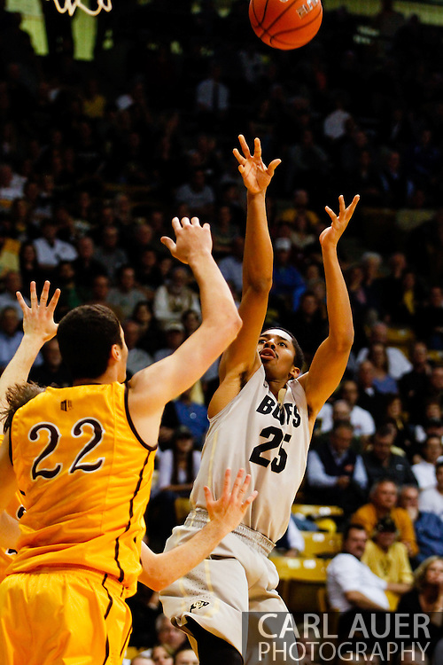 November 13th, 2013:  Colorado Buffaloes junior guard Spencer Dinwiddie (25) shoots over University of Wyoming Cowboys junior forward Larry Nance Jr. (22) in the second half of action in the NCAA Basketball game between the University of Wyoming Cowboys and the University of Colorado Buffaloes at the Coors Events Center in Boulder, Colorado