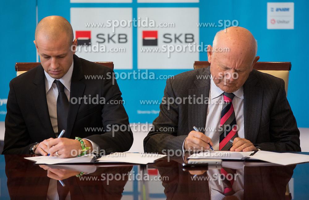 Dejan Kontrec and Janez Kocijancic signing contract at press conference of Olympic committee and Hokejska zveza Slovenije prior to the Qualification for the Olympic games Sochi 2014, on February 1, 2013 in Ljubljana, Slovenia. (Photo By Matic Klansek Velej / Sportida.com)