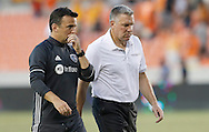 Jun 29, 2016; Houston, TX, USA; Sporting Kansas City head coach Peter Vermes (far right) walks off the field after loosing to the Houston Dynamo in the second half at BBVA Compass Stadium. Dynamo won 3 to 1. Mandatory Credit: Thomas B. Shea-USA TODAY Sports