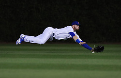 September 13, 2017 - Chicago, IL, USA - Chicago Cubs center fielder Ian Happ misses a single by the New York Mets' Travis Taijeron during the second inning at Wrigley Field in Chicago on Wednesday, Sept., 13, 2017. (Credit Image: © Nuccio Dinuzzo/TNS via ZUMA Wire)