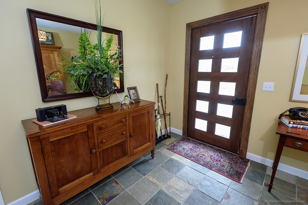 The side entrance foyer at the home of Kristen and David Embry in Pendleton, Ky. Feb. 22, 2018