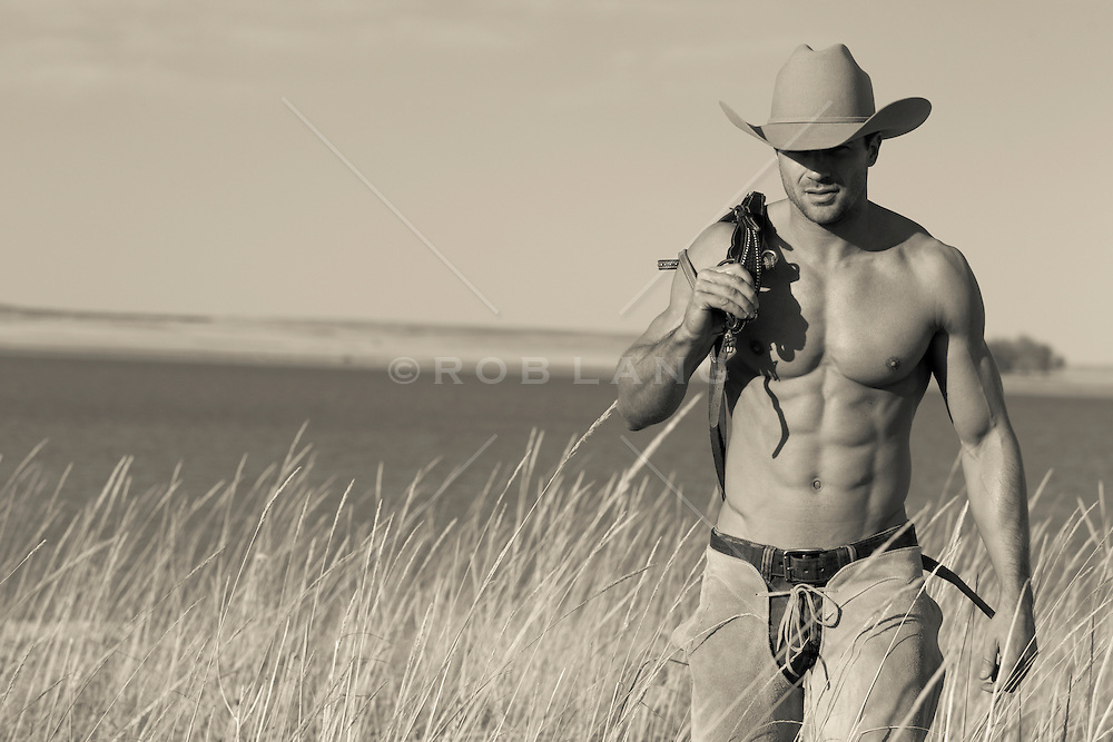shirtless hunky cowboy walking on a ranch in New Mexico