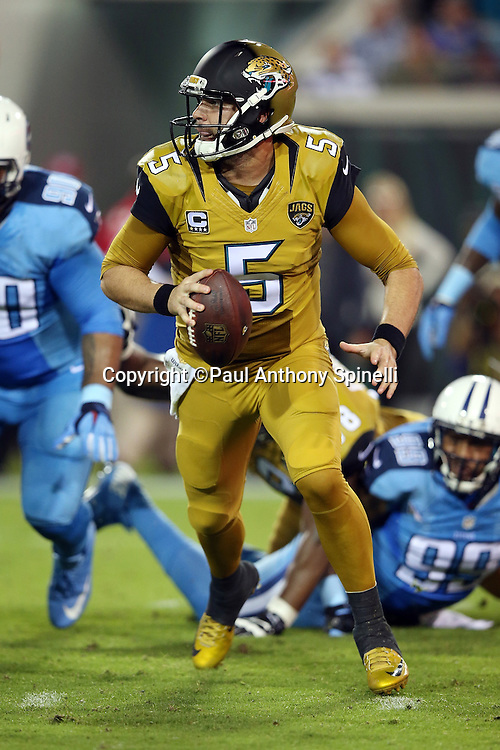 Jacksonville Jaguars quarterback Blake Bortles (5) runs a second quarter keeper for a gain of 13 yards and a first down during the 2015 week 11 regular season NFL football game against the Tennessee Titans on Thursday, Nov. 19, 2015 in Jacksonville, Fla. The Jaguars won the game 19-13. (©Paul Anthony Spinelli)