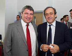 NEWPORT, WALES - Saturday, April 20, 2013: UEFA President Michel Platini with Wales coach Osian Roberts at the opening of the FAW National Development Centre in Newport. (Pic by David Rawcliffe/Propaganda)