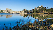 Sylvan Lake reflections. Custer State Park and wildlife reserve in the Black Hills, in Custer County, South Dakota, USA. South Dakota's largest and first state park was named after Lt. Colonel George Armstrong Custer.