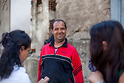 Portrait of a man at the Roma part of Delcevo during door to door activity with Romina. Left Rominas client Jondza Ibraimova. The NGO workers visit families, deliver brochures and putting up posters in the community to inform about health related issues and patients rights.