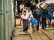 03 NOVEMBER 2015 - YANGON, MYANMAR: A woman and her son walk to a ferry on the Yangon docks.    PHOTO BY JACK KURTZ