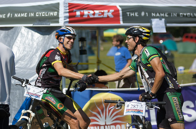 Racers congratulate one another following their finish at the 2007 Shenandoah Mountain 100. The 100 mile mountain bike race winds through the Washington and Jefferson National Forests, and climbs more than 14,000 feet.