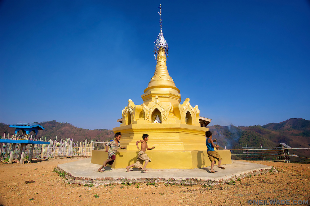 These kids are playing a game of tag on a stupa in a hill village near the town of Kalaw, Myanmar. These religious monuments are very common in Burma and can be found in every village.