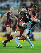 May 25th 2011: Petero Civoniceva of the Maroons is tackled during game 1 of the 2011 State of Origin series at Suncorp Stadium in Brisbane, Australia on May 25, 2011. Photo by Matt Roberts/mattrIMAGES.com.au / QRL