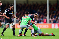 Phil Dollman of Exeter Chiefs is tackled by Marcus Smith of Harlequins - Mandatory by-line: Ryan Hiscott/JMP - 27/04/2019 - RUGBY - Sandy Park - Exeter, England - Exeter Chiefs v Harlequins - Gallagher Premiership Rugby