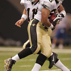 2008 August 28: Running back Deuce McAllister (26) takes the handoff from quarterback Mark Brunell of the New Orleans Saints against the Miami Dolphins in a preseason match up at the Louisiana Superdome in New Orleans, LA.