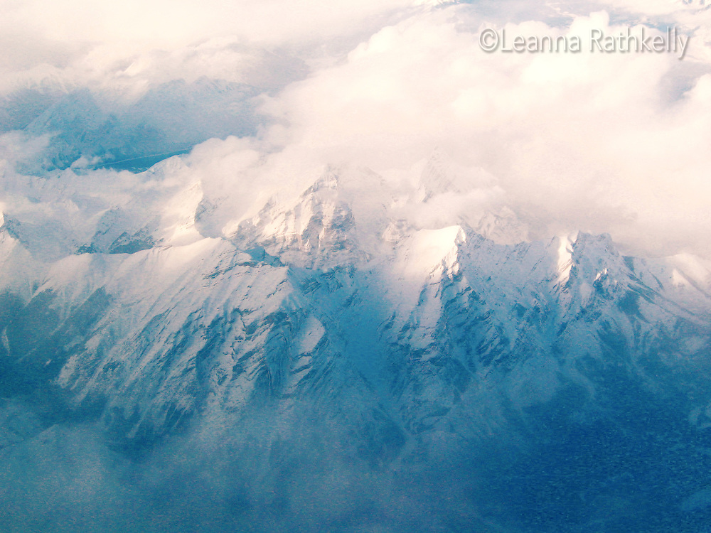 The Rocky Mountains on a winter day, as seen from an airplane.