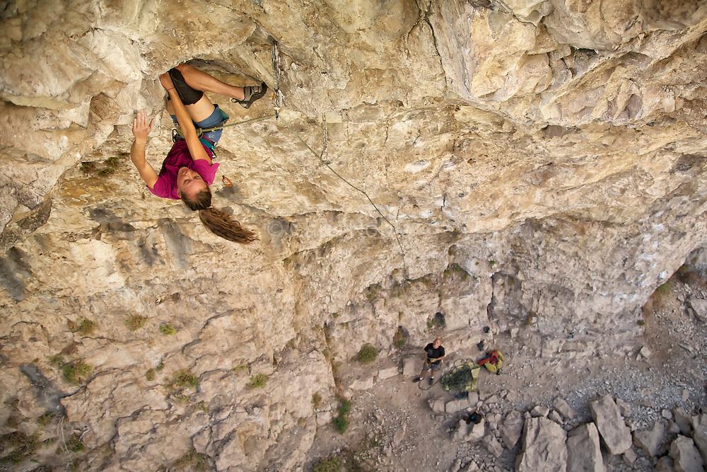"Lauren Lee McCormick climbing ""Rendezspew,"" 13a, Rifle Mountain Park, Rifle Colorado."