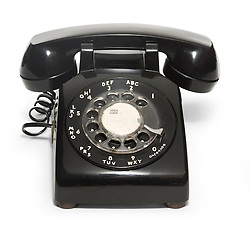 Black 1950's telephone on a white background