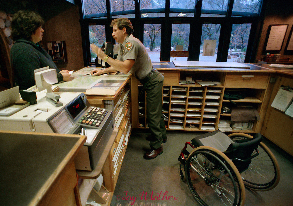 Mark Wellman, the first paraplegic climber to scale El Capitan in July 1989 and Yosemite National Park ranger, works in the park's visitor center providing information and advice to visitors.  November 1989