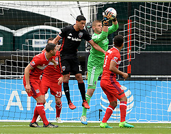 May 20, 2017 - Washington, DC, USA - 20170520 - Chicago Fire goalkeeper MATT LAMPSON (28) brings down the ball against D.C. United midfielder LAMAR NEAGLE (13), during a D.C. United corner kick in the first half at RFK Stadium in Washington. (Credit Image: © Chuck Myers via ZUMA Wire)