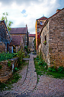 Narrow alley in the fairy tale medieval village of Chateauneuf-en-Auxois.