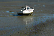 Small launch is left high and dry at low tide. 22/4/2004 (© 2004 Chris Cameron)