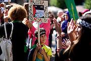 Mainz | 18 July 2014<br /> <br /> Am Samstag (18.07.2014) nahmen etwa 1000 M&auml;nner, Frauen und Kinder in der Innenstadt von Mainz anl&auml;sslich der milit&auml;rischen Auseinandersetzung zwischen Israel und der Hamas in Gaza an einer Solidarit&auml;tsdemonstration f&uuml;r Gaza, ein freies Pal&auml;stina und gegen Israel teil. Bei der Demo wurden Fahnen der Hamas und der Hisbollah mitgef&uuml;hrt, neben den &uuml;blichen Parolen gegen Israel wurde in Sprechch&ouml;hren auch vereinzelt zur Vernichtung von J&uuml;dinnen und Juden aufgerufen.<br /> Hier: Ein Junge mit einem kleinen &quot;Free gaza - Free Palestine&quot;-Plakat.<br /> <br /> <br /> &copy;peter-juelich.com<br /> <br /> [No Model Release | No Property Release]