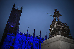 © Licensed to London News Pictures . FILE PICTURE DATED 17/11/2013 of church and war memorial in Oldham Town Centre.  Oldham has been named England's most deprived town by the Office for National Statistics today (18th March 2016) . Photo credit : Joel Goodman/LNP