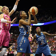 Damiris Dantas, (right), Minnesota Lynx, drives to the basket defended by Katie Douglas, Connecticut Sun,  in action during the Connecticut Sun Vs Minnesota Lynx, WNBA regular season game at Mohegan Sun Arena, Uncasville, Connecticut, USA. 27th July 2014. Photo Tim Clayton