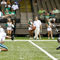 Oct 5, 2013; New Orleans, LA, USA; Tulane Green Wave kicker Cairo Santos (19) connects on a game winning field goal against the North Texas Mean Green during the fourth quarter at Mercedes-Benz Superdome. Tulane defeated North Texas 24-21.Mandatory Credit: Derick E. Hingle-USA TODAY Sports