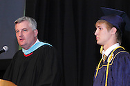 Principal Paul J. Waller (left) introduces class president Zachary Harmony during the Oakwood High School 88th annual commencement at the Dayton Convention Center in downtown Dayton, Monday, June 4, 2012.