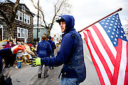 """Captain"" Johhny Conklin leads his band of volunteer disaster relief workers through their Broad Channel neighborhood in Queens, N.Y., to help less able-bodied residents clean up debris left by Hurricane Sandy, Nov. 3, 2012."