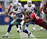 DALLAS, TX - SEPTEMBER 23:  Kevin Ogletree #85 of the Dallas Cowboys is tackled by Mason Foster #59 of the Tampa Bay Buccaneers at Cowboys Stadium on September 23, 2012 in Dallas, Texas.  The Cowboys defeated the Buccaneers 16-10.  (Photo by Wesley Hitt/Getty Images) *** Local Caption *** Kevin Ogletree; Mason Foster