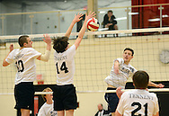 WARMINSTER, PA - APRIL 23:  Council Rock North's Nick Reich #28 hits the ball across the net as William Tennent's Brian Ebbert #10 and Josh Ferguson #14 defend during the first half at William Tennent April 23, 2014 in Warminster, Pennsylvania.  (Photo by William Thomas Cain/Cain Images)