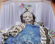 The body of a deceased family member inside a decorated coffin.<br /> <br /> Ma'nene is a tradition that takes place in August after harvest where the bodies of the dead loved ones are exhumed to be cleaned, groomed and dressed. For most, it's a bittersweet moment, a chance to reunite and physically see and touch and reconnect with loved ones who had passed on.