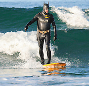 Surfing in a Batman Halloween Costume in Orange County