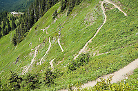 A view looking down at switchbacks and hikers on the Sauk Mountain trail in the Washington Cascades, USA.