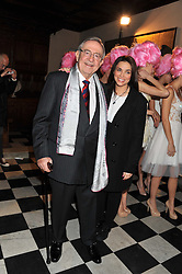HM KING CONSTANTINE OF GREECE and fashion designer CELIA KRITHARIOTI at a fashion show featuring designs from Celia Kritharioti Spring/Summer 2012 collection held at One Mayfair, London on 20th March 2012.