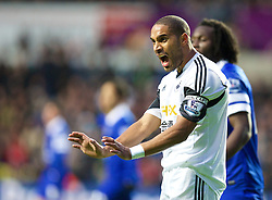 SWANSEA, WALES - Sunday, December 22, 2013: Swansea City's captain Ashley Williams in action against Everton during the Premiership match at the Liberty Stadium. (Pic by David Rawcliffe/Propaganda)