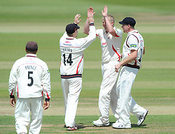 Glen Chapple celebrates with Karl Brown as he bowls Ian Cockbain of Gloucestershire for 28 - Photo mandatory by-line: Dougie Allward/JMP - Mobile: 07966 386802 - 08/06/2015 - SPORT - Football - Bristol - County Ground - Gloucestershire Cricket v Lancashire Cricket Day 2 - LV= County Championship