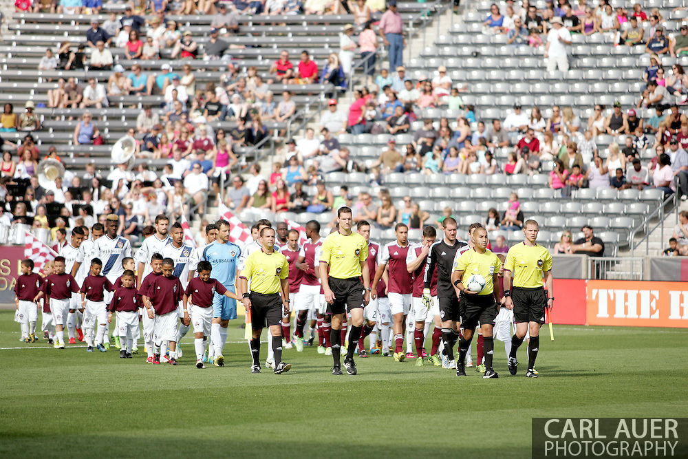 July 27th, 2013 - The LA Galaxy and Colorado Rapids follow the officials onto the pitch prior to the start of action in the Major League Soccer match between the LA Galaxy and the Colorado Rapids at Dick's Sporting Goods Park in Commerce City, CO