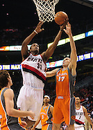 Mar. 21 2010; Phoenix, AZ, USA; Portland Trailblazers forward Dante Cunningham (33) puts up a shot against Phoenix Suns center Louis Amundson (17) in the first half at the US Airways Center.   Mandatory Credit: Jennifer Stewart-US PRESSWIRE.