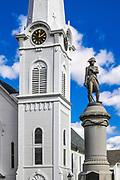 Congregational church clock tower and verterans memorial statue, Manchester, Vermont, USA.